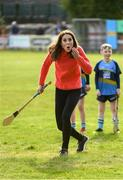 5 March 2020; Catherine, Duchess of Cambridge, reacts after making an attempt to hit a sliothar with a hurley during an engagement at Salthill Knocknacarra GAA Club in Galway during day three of her visit to Ireland. Photo by Sam Barnes/Sportsfile