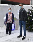 23 December 2020; James McCarthy, a member of the victorious 6-in-a-row All-Ireland winning Dublin Senior Football Team, with Burns Specialist Nurse Tina McGarry during a socially distanced visit to Children's Health Ireland Hospital at Crumlin in Dublin. Photo by Ray McManus/Sportsfile