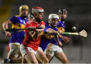 23 December 2020; Conor O'Callaghan of Cork in action against Devon Ryan of Tipperary during the Bord Gáis Energy Munster GAA Hurling U20 Championship Final match between Cork and Tipperary at Páirc Uí Chaoimh in Cork. Photo by Matt Browne/Sportsfile