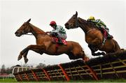 26 December 2020; Zanahiyr, left, with Jack Kennedy up, jumps the last alongside eventual second place Busselton, with JJ Slevin up, on their way to winning the Knight Frank Juvenile Hurdle on day one of the Leopardstown Christmas Festival at Leopardstown Racecourse in Dublin. Photo by Seb Daly/Sportsfile
