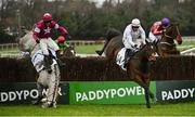 26 December 2020; Jan Maat, left, and jockey Hugh Morgan fall at the last alongside eventual third place Emily Moon, with Paddy Kennedy up, during the 'Bet Through The Free Racing Post App' Handicap Steeplechase on day one of the Leopardstown Christmas Festival at Leopardstown Racecourse in Dublin. Photo by Seb Daly/Sportsfile
