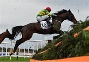 26 December 2020; Uisce Beatha, with Simon Torrens up, jumps the first on their way to winning the 'Bet Through The Free Racing Post App' Handicap Steeplechase on day one of the Leopardstown Christmas Festival at Leopardstown Racecourse in Dublin. Photo by Seb Daly/Sportsfile
