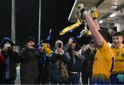 26 December 2020; Eoin Colleran of Roscommon lifts the trophy, watched by parents and guardians, following the Electric Ireland Connacht GAA Football Minor Championship Final match between Roscommon and Sligo at Connacht Centre of Excellence in Bekan, Mayo. Photo by Ramsey Cardy/Sportsfile