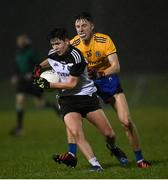 26 December 2020; Mark Heraghty of Sligo in action against Shane Walsh of Roscommon during the Electric Ireland Connacht GAA Football Minor Championship Final match between Roscommon and Sligo at Connacht Centre of Excellence in Bekan, Mayo. Photo by Ramsey Cardy/Sportsfile