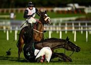 27 December 2020; Jockey Darragh O'Keeffe, riding Soviet Pimpernel, takes evasive action to avoid the fallen Jungle Junction and jockey Paddy Kennedy at the last during the Paddy Power Games 'Don't Think You're Special' Beginners Steeplechase on day two of the Leopardstown Christmas Festival at Leopardstown Racecourse in Dublin. Photo by Seb Daly/Sportsfile