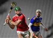 23 December 2020; Colin O' Brien of Cork shoots as Eoghan Connolly of Tipperary looks on during the Bord Gáis Energy Munster GAA Hurling U20 Championship Final match between Cork and Tipperary at Páirc Uí Chaoimh in Cork. Photo by Piaras Ó Mídheach/Sportsfile