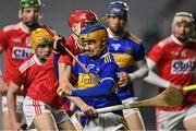 23 December 2020; Darragh Flannery of Tipperary is tackled by Alan Connolly of Cork during the Bord Gáis Energy Munster GAA Hurling U20 Championship Final match between Cork and Tipperary at Páirc Uí Chaoimh in Cork. Photo by Piaras Ó Mídheach/Sportsfile