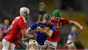 23 December 2020; James Devaney of Tipperary is tackled by Aaron Walsh Barry of Cork during the Bord Gáis Energy Munster GAA Hurling U20 Championship Final match between Cork and Tipperary at Páirc Uí Chaoimh in Cork. Photo by Piaras Ó Mídheach/Sportsfile