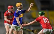 23 December 2020; Andrew Ormond of Tipperary in action against Ciarán Joyce, left, and Eoin Carey of Cork during the Bord Gáis Energy Munster GAA Hurling U20 Championship Final match between Cork and Tipperary at Páirc Uí Chaoimh in Cork. Photo by Piaras Ó Mídheach/Sportsfile