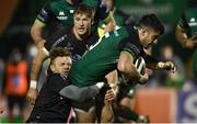 27 December 2020; Tiernan O'Halloran of Connacht is tackled by Ian Madigan of Ulster during the Guinness PRO14 match between Connacht and Ulster at The Sportsground in Galway. Photo by Ramsey Cardy/Sportsfile