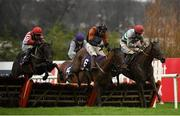 28 December 2020; Dandy Mag, left, with Paul Townend up, jumps the last behind eventual second and third places The Bosses Oscar, right, with Bryan Cooper up, and Unexpected Depth, centre, with Liam McKenna up, on their way to winning the Pertemps Network Handicap Hurdle on day three of the Leopardstown Christmas Festival at Leopardstown Racecourse in Dublin. Photo by Seb Daly/Sportsfile
