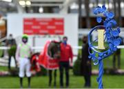 29 December 2020; A view of the winner's position sign in the winners enclosure, as jockey Patrick Mullins, trainer Willie Mullins and Sharjah stand for a photograph following victory in the Matheson Hurdle on day four of the Leopardstown Christmas Festival at Leopardstown Racecourse in Dublin. Photo by Seb Daly/Sportsfile