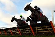 29 December 2020; Sharjah, left, with Patrick Mullins up, jumps the last alongside eventual second place Aspire Tower, right, with Rachael Blackmore up, on their way to winning the Matheson Hurdle on day four of the Leopardstown Christmas Festival at Leopardstown Racecourse in Dublin. Photo by Seb Daly/Sportsfile