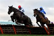 29 December 2020; Millen To One, left, with Jack Kennedy up, jumps the last alongside eventual third place Jacksons Gold, with Ian Power up, on their way to winning the Irish Stallion Farms EBF Novice Handicap Hurdle on day four of the Leopardstown Christmas Festival at Leopardstown Racecourse in Dublin. Photo by Seb Daly/Sportsfile