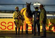 1 January 2021; Jockey Paul Townend, trainer Willie Mullins and Al Boum Photo in the winners enclosure following victory in the Savills New Year's Day Steeplechase at Tramore Racecourse in Waterford. Photo by Seb Daly/Sportsfile