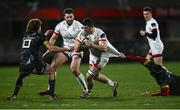 2 January 2021; Nick Timoney of Ulster is tackled by Chris Cloete, right, and Ben Healy of Munster during the Guinness PRO14 match between Ulster and Munster at Kingspan Stadium in Belfast. Photo by David Fitzgerald/Sportsfile