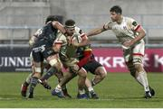 2 January 2021; Rob Herring of Ulster is tackled by Chris Cloete and Billy Holland of Munster during the Guinness PRO14 match between Ulster and Munster at Kingspan Stadium in Belfast. Photo by John Dickson/Sportsfile