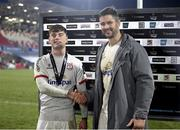 2 January 2021; Ethan McIlroy of Ulster receives his Player Of The Match Award from Ulster captain Sam Carter following the Guinness PRO14 match between Ulster and Munster at Kingspan Stadium in Belfast. Photo by John Dickson/Sportsfile