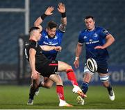 8 January 2021; John Cooney of Ulster kicks under pressure from Andrew Porter of Leinster during the Guinness PRO14 match between Leinster and Ulster at the RDS Arena in Dublin. Photo by Seb Daly/Sportsfile