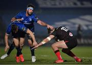 8 January 2021; Stuart McCloskey of Ulster evades the tackle of Leinster's Jordan Larmour and Caelan Doris during the Guinness PRO14 match between Leinster and Ulster at the RDS Arena in Dublin. Photo by Seb Daly/Sportsfile