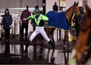 11 January 2021; Jockey Donagh O'Connor jumps a puddle in the parade ring prior to the Join Us On Instagram @dundalk_stadium Handicap DIV II at Dundalk Stadium, in Louth. Photo by Seb Daly/Sportsfile