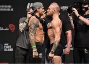 22 January 2021; Dustin Poirier, left, and Conor McGregor face off during the UFC 257 weigh-in at the Etihad Arena on UFC Fight Island in Abu Dhabi, United Arab Emirates. Photo by Jeff Bottari/Zuffa LLC/Getty Images via Sportsfile