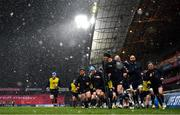 23 January 2021; Leinster captain Jonathan Sexton leads his side in their warm up as snow falls prior to the Guinness PRO14 match between Munster and Leinster at Thomond Park in Limerick. Photo by Eóin Noonan/Sportsfile