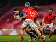 23 January 2021; Hugo Keenan of Leinster is tackled by Tadhg Beirne and Chris Farrell of Munster during the Guinness PRO14 match between Munster and Leinster at Thomond Park in Limerick. Photo by Eóin Noonan/Sportsfile