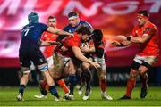 23 January 2021; Rhys Marshall of Munster is tackled by Will Connors, left, and Seán Cronin of Leinster during the Guinness PRO14 match between Munster and Leinster at Thomond Park in Limerick. Photo by Eóin Noonan/Sportsfile