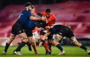 23 January 2021; CJ Stander of Munster is tackled by Leinster players, from left, Caelan Doris, Seán Cronin and Rhys Ruddock during the Guinness PRO14 match between Munster and Leinster at Thomond Park in Limerick. Photo by Eóin Noonan/Sportsfile