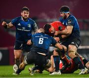 23 January 2021; CJ Stander of Munster is tackled by Rhys Ruddock, left, and Caelan Doris of Leinster during the Guinness PRO14 match between Munster and Leinster at Thomond Park in Limerick. Photo by Eóin Noonan/Sportsfile