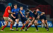 23 January 2021; Caelan Doris of Leinster, supported by team-mate Andrew Porter, is tackled by Jean Kleyn of Munster during the Guinness PRO14 match between Munster and Leinster at Thomond Park in Limerick. Photo by Ramsey Cardy/Sportsfile