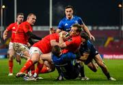 23 January 2021; Mike Haley of Munster is tackled by Luke McGrath and Hugo Keenan of Leinster during the Guinness PRO14 match between Munster and Leinster at Thomond Park in Limerick. Photo by Ramsey Cardy/Sportsfile