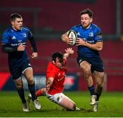 23 January 2021; Hugo Keenan of Leinster beats the tackle of Niall Scannell of Munster during the Guinness PRO14 match between Munster and Leinster at Thomond Park in Limerick. Photo by Ramsey Cardy/Sportsfile