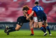 23 January 2021; Ben Healy of Munster is tackled by Rónan Kelleher, left, and Ross Byrne of Leinster during the Guinness PRO14 match between Munster and Leinster at Thomond Park in Limerick. Photo by Eóin Noonan/Sportsfile
