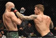 24 January 2021; Conor McGregor, left, and Dustin Poirier during their UFC 257 Lightweight bout at the Etihad Arena in Abu Dhabi, United Arab Emirates. Photo by Jeff Bottari/Zuffa LLC/Getty Images via Sportsfile