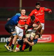 23 January 2021; Peter O'Mahony of Munster is tackled by Will Connors, left, and Garry Ringrose of Leinster during the Guinness PRO14 match between Munster and Leinster at Thomond Park in Limerick. Photo by Ramsey Cardy/Sportsfile