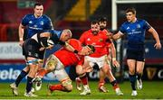 23 January 2021; Rhys Ruddock of Leinster is tackled by Gavin Coombes of Munster during the Guinness PRO14 match between Munster and Leinster at Thomond Park in Limerick. Photo by Ramsey Cardy/Sportsfile