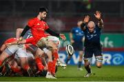 23 January 2021; Rhys Ruddock of Leinster attempts to charge down a kick by Conor Murray of Munster during the Guinness PRO14 match between Munster and Leinster at Thomond Park in Limerick. Photo by Ramsey Cardy/Sportsfile