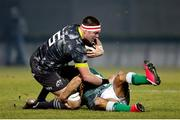 30 January 2021; Billy Holland of Munster is tackled by Ignacio Brex of Benetton Rugby during the Guinness PRO14 match between Benetton and Munster at Stadio Monigo in Treviso, Italy. Photo by Roberto Bregani/Sportsfile