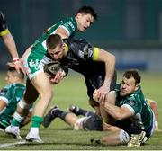 30 January 2021; Liam Coombes of Munster is tackled by Tomas Baravalle of Benetton during the Guinness PRO14 match between Benetton and Munster at Stadio Monigo in Treviso, Italy. Photo by Roberto Bregani/Sportsfile