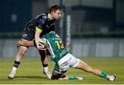 30 January 2021; Rory Scannell of Munster is tackled by Ignacio Brex of Benetton Rugby during the Guinness PRO14 match between Benetton and Munster at Stadio Monigo in Treviso, Italy. Photo by Roberto Bregani/Sportsfile