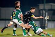 30 January 2021; Rory Scannell of Munster offloads as he is tackled by Ignacio Brex of Benetton during the Guinness PRO14 match between Benetton and Munster at Stadio Monigo in Treviso, Italy. Photo by Roberto Bregani/Sportsfile