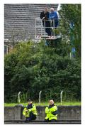 """26 July 2020; Cherry-picking their spot. It's two up and two down as Toomevara supporters Paddy Shanahan, left, and Séamus O'Meara show they have a head for heights at Nenagh while Garda Richie Kennedy, left, and Garda Darren Owens look on from ground level. Photo by Piaras Ó Mídheach/Sportsfile This image may be reproduced free of charge when used in conjunction with a review of the book """"A Season of Sundays 2020"""". All other usage © Sportsfile"""