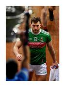 """19 December 2020; Slippery Sam, elusive and still out of reach. Aidan O'Shea has a quick look as Colm Basquel takes his turn to lift the Sam Maguire Cup, no doubt wondering when he and Mayo will reach the holy grail. This is the county's 10th All-Ireland final loss since they last won the title in 1951 and O'Shea's fifth time to be on the losing team in a decider. Photo by Brendan Moran/Sportsfile This image may be reproduced free of charge when used in conjunction with a review of the book """"A Season of Sundays 2020"""". All other usage © Sportsfile"""