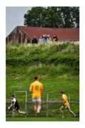"""17 July 2020; You can close the gates but it won't stop them watching. Young spectators locate a useful vantage point to follow the play between Clonduff and Kilcoo at Clonduff Park in Newry. Photo by Sam Barnes/Sportsfile This image may be reproduced free of charge when used in conjunction with a review of the book """"A Season of Sundays 2020"""". All other usage © Sportsfile"""