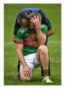 """27 September 2020; Say it ain't so. Noel McGrath, being comforted by his team manager and uncle Frankie McGrath, endures the anguish of losing a county final in the last minute for the second time in seven days - sometimes lightning does strike twice. After Kiladangan broke Loughmore-Castleiney's hearts in the hurling decider the previous Sunday, Clonmel Commercials pile on the agony with a point in the last minute of normal time, and so take their fifth football title of the decade. Photo by Ray McManus/Sportsfile This image may be reproduced free of charge when used in conjunction with a review of the book """"A Season of Sundays 2020"""". All other usage © Sportsfile"""