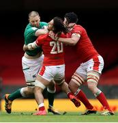 7 February 2021; Iain Henderson of Ireland is tackled by Josh Navidi and Adam Beard of Wales during the Guinness Six Nations Rugby Championship match between Wales and Ireland at the Principality Stadium in Cardiff, Wales. Photo by Chris Fairweather/Sportsfile