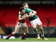 7 February 2021; Robbie Henshaw of Ireland is tackled by Dan Biggar of Wales during the Guinness Six Nations Rugby Championship match between Wales and Ireland at the Principality Stadium in Cardiff, Wales. Photo by Chris Fairweather/Sportsfile