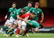 7 February 2021; Robbie Henshaw of Ireland is tackled by George North of Wales and Jonathan Sexton of Ireland during the Guinness Six Nations Rugby Championship match between Wales and Ireland at the Principality Stadium in Cardiff, Wales. Photo by Chris Fairweather/Sportsfile